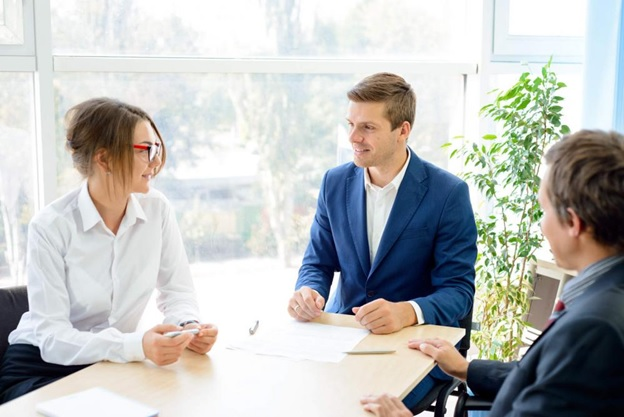 A woman consulting with a team of professional document attestation experts